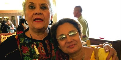 UNM alumna and author Denise Chavez (left) pictured with Professor Feroza Jussawalla (right)